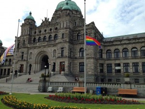 The Pride and B.C. flags fly at half mast at the B.C. Legislature (photo credit: Rob Shaw)
